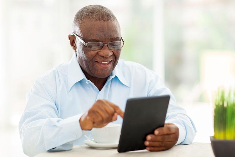 black mature elderly male eyewear on tablet