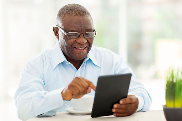black mature elderly male eyewear on tablet